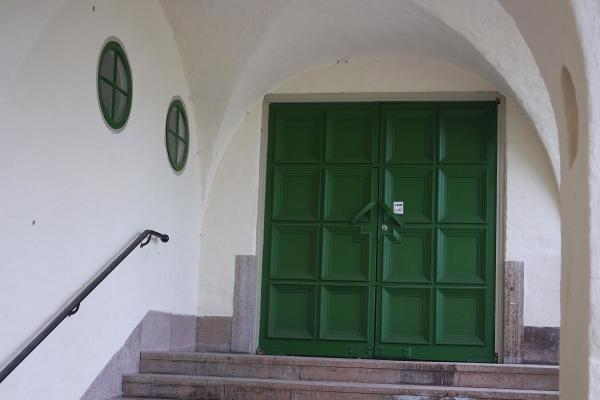 Entrance with green doors