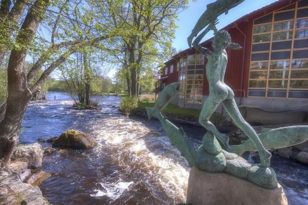 Statue in Mörrum river next to Laxens Hus