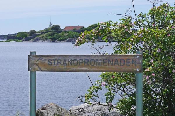 Wooden sign and view of the sea and Kastellet