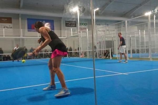 Padel court with players