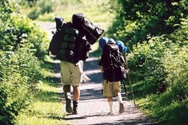 Two hikers with packing